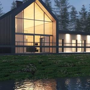 duży oszklony dom nad jeziorem